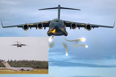 On the ground and in the air, the C-17 is a formidable machine-C-17 releasing flares