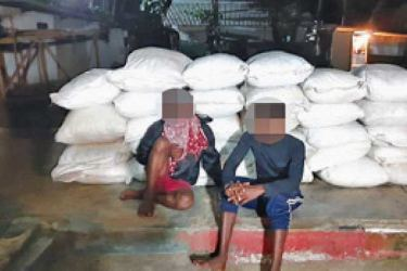 The two suspects along with dinghy and the sacks containing 1050kg of dried turmeric.