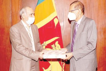 Foreign Minister Prof. G.L. Peiris met the Charge d' Affaires of the Embassy of the State of Libya in Sri Lanka Amar A.M.Muftah at the Foreign Ministry on Wednesday.