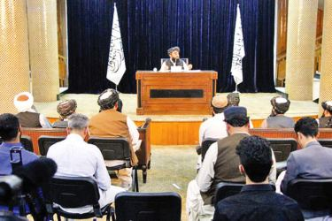 Taliban Spokesman Zabihullah Mujahid speaks during a press conference in Kabul, Afghanistan on Tuesday to announce the formation of Afghanistan's caretaker Government. - XINHUA