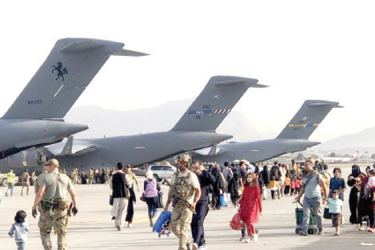 Afghans heading to USAF C17  Globemasters for flights to third countries or US.