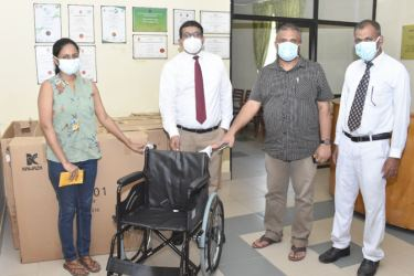 Our picture shows Dr Nimasha handing over her and her friend's donations to the Medical Superintendent of the Hospital Dr M.H.M. Azath, Dr.A. Mufaris, and Matron M. M. Nowfel.