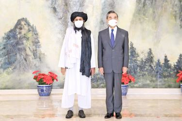 Chinese Foreign Minister Wang Yi with a senior Taliban representative.