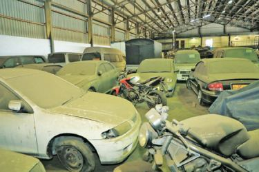 Corroded vehicles and other items stored at the warehouse.