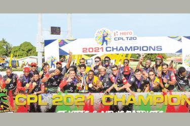 St. Kitts and Nevis Patriots celebrate with the trophy