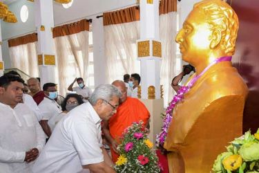 President Gotabaya Rajapaksa places a floral tribute at the statue of Anagarika Dharmapala at a previous commemoration ceremony.