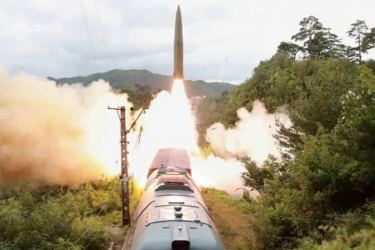A missile is seen launched during a drill of the Railway Mobile Missile Regiment in North Korea.