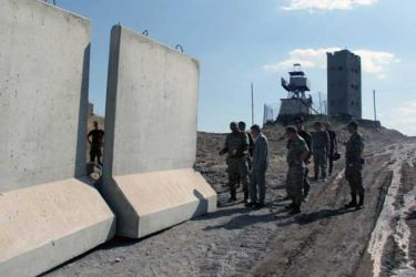 Local officials visit the construction site of a security wall on Turkey's border with Iran in Agri province, Turkey.