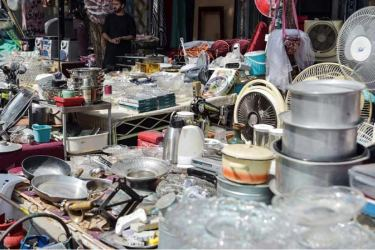 Shopkeepers displaying second-hand household items for sale at a market in the northwest neighbourhood of Khair Khana in Kabul.