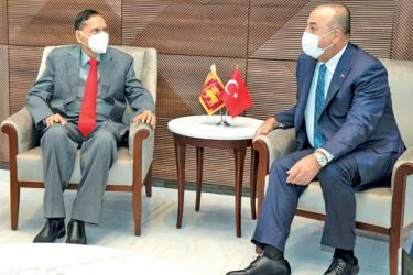 Foreign Minister Prof. G.L. Peiris meeting Turkish Foreign Minister Mevlüt Çavusoglu at the Turkish Permanent Mission in New York on Friday.