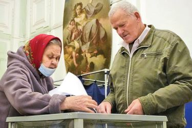 People cast their ballots during the State Duma, the Lower House of the Russian Parliament and Local Parliaments Elections at a polling station situated in an old palace in St. Petersburg, Russia on Saturday.