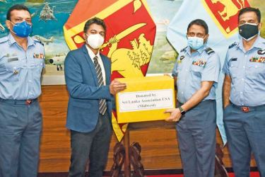 President of the Sri Lanka Association USA (Midwest) Professor Ravin Kodikara making the donation to SLAF Director Health Services Air Vice Marshal Dr. Lalith Jayaweera at the Air Force Headquarters on Tuesday.