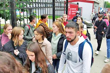 Students gather on Monday after a gunman opened fire at their university in the Russian city of Perm.