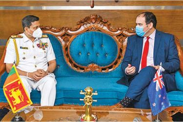 Navy Commander Vice Admiral Nishantha Ulugetenne having discussion with New Zealand High Commissioner to Sri Lanka Michael Edward Appleton.
