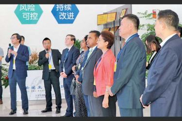 Ambassador of Sri Lanka to China Dr. Palitha Kohona and Embassy officials visiting Sinopharm's Beijing Institute of Biological Products Co., Ltd. (CNBG) on Thursday.