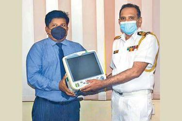 Acting Health Services Director General Surgeon Commodore P.J.B. Marambe receiving the MPMs symbolically.