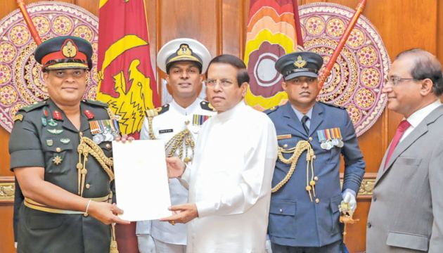 Lt. General Shavendra Silva received the appointment letter as the 23rd Commander of the Sri Lanka Army from President Maithripala Sirisena on Monday. Secretary to the President Udaya R. Seneviratne is also in the picture. Picture by Sudath Silva