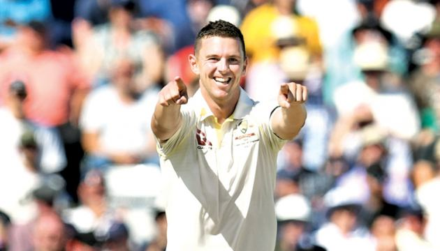 Australia's Josh Hazlewood (C) celebrates taking the wicket of England's Jack Leach on the second day of the third Ashes cricket Test match between England and Australia at Headingley in Leeds, northern England, on Friday. - AFP