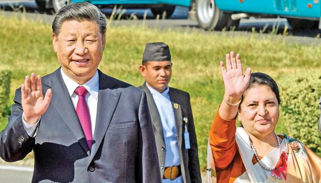 Nepal's President Bidhya Devi Bhandari (R) and China's President Xi Jinping  wave as the latter bids farewell, wrapping up his two-day visit to Nepal, in Kathmandu on Sunday. - Nepal rolled out the red carpet for China's President Xi Jinping during the first state visit by a Chinese leader in 23 years. - AFP