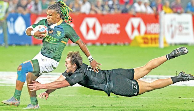 Rosko Specman of South Africa (L) is tackled by Joe Webber of New Zealand during the HSBC Dubai Sevens Series final men's rugby match between South Africa and New Zealand at The Sevens Stadium in Dubai on December. AFP