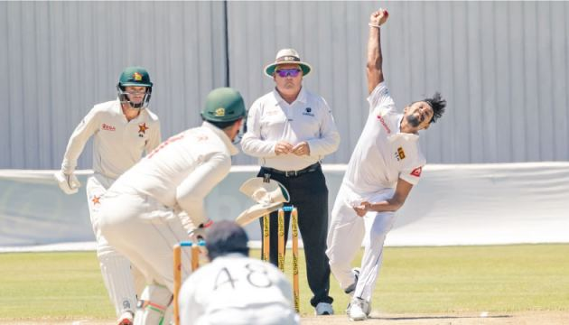 Sri Lanka's Suranga Lakmal bowling to Zimbabwe's captain Sean Williams (2ndL) as Brendan Taylor (L) and Niroshan Dickwella (front) looks on during the fifth day of the first Test cricket match at the Harare Sports Club in Harare on Thursday. - AFP