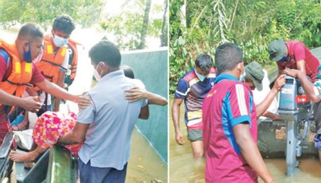 Rescue workers helping those affected by the floods. Pictures by Mahinda P. Liyanage, Galle Central Special Corr.