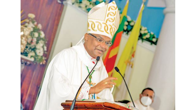 Bishop of the Diocese of Galle Rev. Dr. Raymond Wickremesinghe  blessing the statue of Our Lady of Matara.