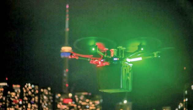 This handout photo released by Unither Bioelectronique and taken in September 2021 shows Unither Bioelectronique's drone transporting a pair of donor lungs, high above Toronto traffic at night.