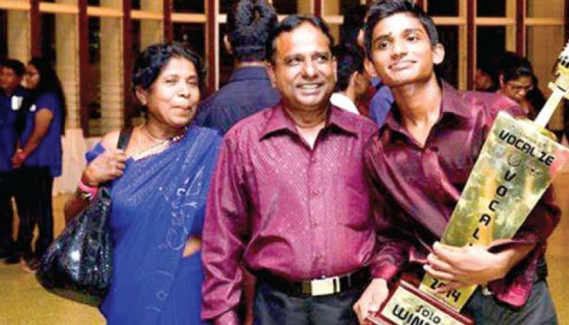 With his parents the day he won Vocalize