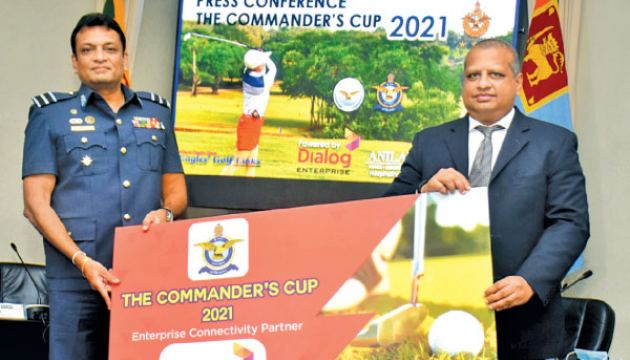 The sponsorship cheque symbolically handed over by Vice President of Enterprise Business and Large Enterprise Sales – Dialog Axiata Plc, Navin Peiris (right) to the Chairman of Organizing Committee - Commander's Cup, Air Commodore Prasanna Ranasinghe (left). Picture by Gayan Pushpika