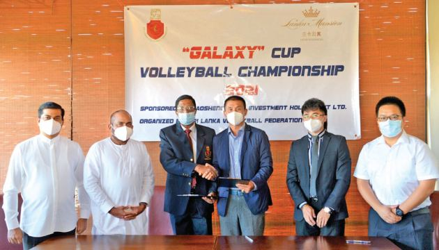 The officials of SLVF and the Chinese company exchanging the Memorandum of Understanding for the Galaxy Cup volleyball tourney.