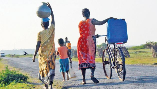 Some rural villagers have to trek many miles to obtain potable water.