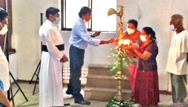 St. Joseph's  Church, Chief Priest   and  patients  lighting  the traditional oil lamp before starting the Free Medical camp