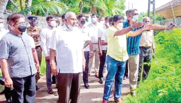 Minister Gamini Lokuge along with Officials inspecting the area.
