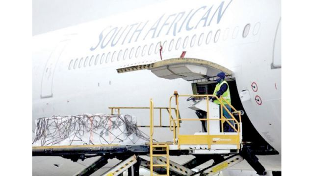 A worker looks on as a stock of the Johnson & Johnson coronavirus disease (COVID-19) vaccine is offloaded at the O.R Tambo International Airport in Johannesburg, South Africa.
