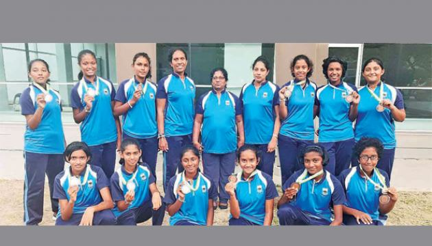 The touring Netball team of Girls' High School during the Malaysian tour (Vihara Standing first from left). Pictures. by Upananda Jayasundera