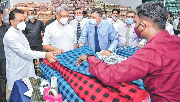 Flashback: President Gotabaya Rajapaksa with Minister of Industries Wimal Weerawansa visiting Creative Textile Mill, Dankotuwa. Managing Director, Feroze Anver is also in the picture
