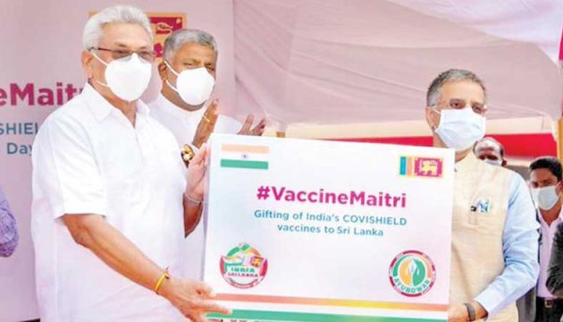 President Gotabaya Rajapaksa receiving the first consignment of 'Vaccine Maitri' vaccine from Indian High Commissioner to Sri Lanka Gopal Baglay.