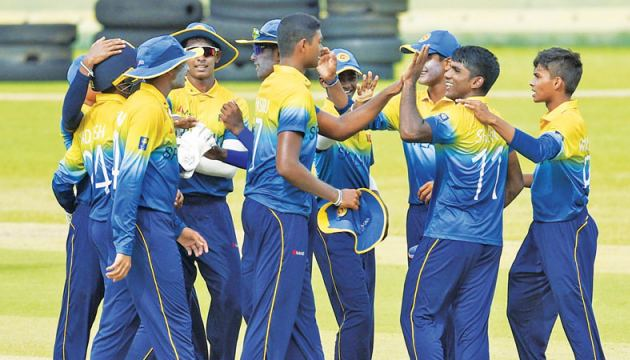 Shevon Daniel (2nd from right) celebrates a dismissal with his teammates in the first ODI. (Pic courtesy SLC)
