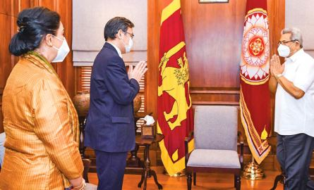President Gotabaya Rajapaksa greeting Japanese Ambassador Akira Sugiyama on his arrival at  the Presidential Secretariat yesterday to officially hand over the stock of AstraZeneca vaccines donated by the Government of Japan. Picture courtesy President's Media Division