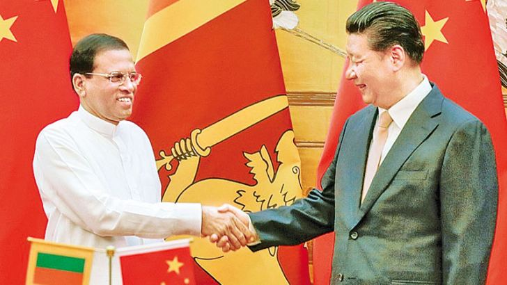 President Maithripala Sirisena and Chinese President Xi Jinping attend a welcoming ceremony at the Great Hall of the People in Beijing last year.