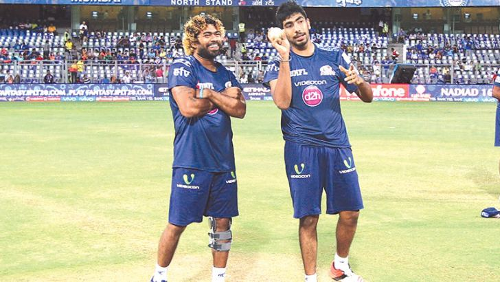The master and the protégé: Lasith Malinga and Jasprit Bumrah have a chat during a Mumbai Indians training session on Saturday.