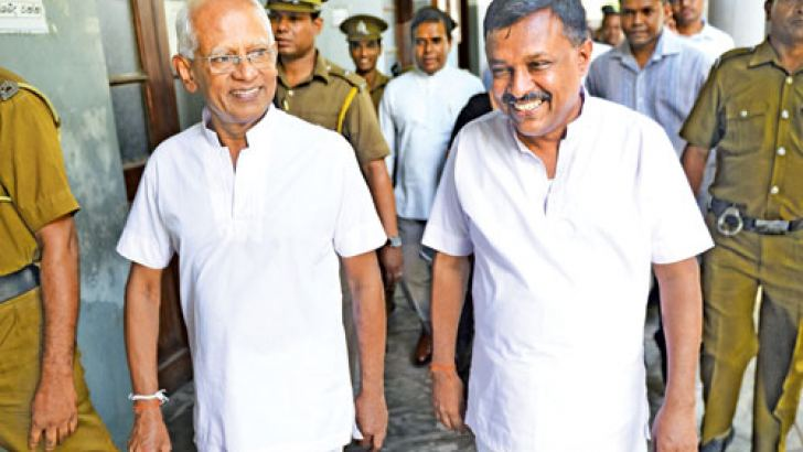 Former Secretary to the President Lalith Weeragunga and former TRCSL Director General Anusha Pelpita leaving the court  premises. Picture by Dushmantha Mayadune