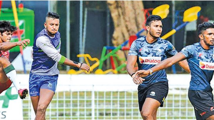 Sri Lankan rugby sevens team members at a practice session.