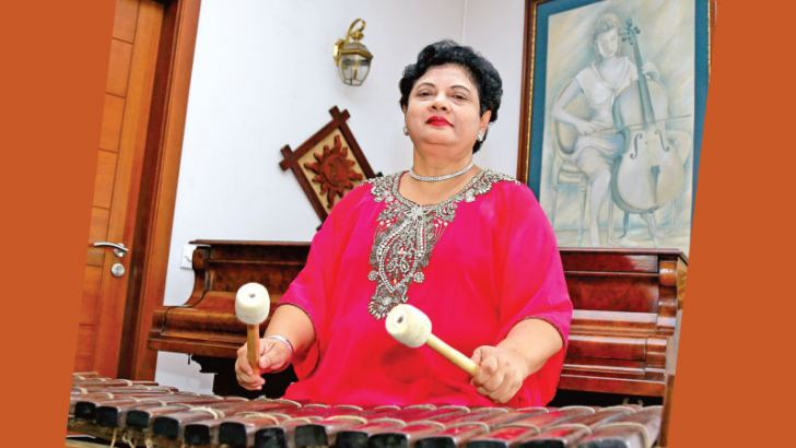 """Playing African Xylophone known as the """"Balafon"""" or """"Balangi"""". Pictures by Nirosh Batepola"""