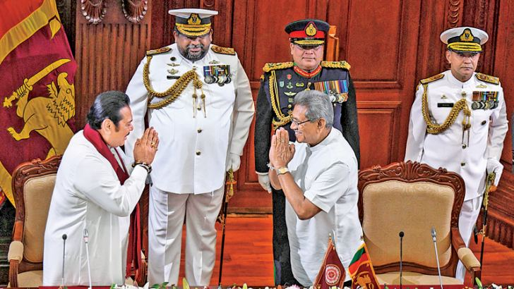 SWEARING-IN OF NEW PM: Former President Mahinda Rajapaksa who was sworn-in as Prime Minister greets President Gotabaya Rajapaksa at the swearing-in ceremony at the Presidential Secretariat yesterday. - AFP