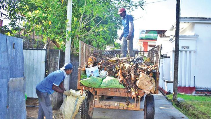 Garbage cleaning as part of the shramadana campaign. Picture by M.A. Phakurdeen, Addalaichenai Group Corr.