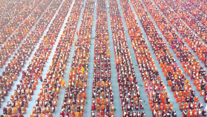 As the sun rose over the ancient town of Mandalay in Myanmar, a sea of saffron and maroon-robed monks assembled in an area the size of a football field.