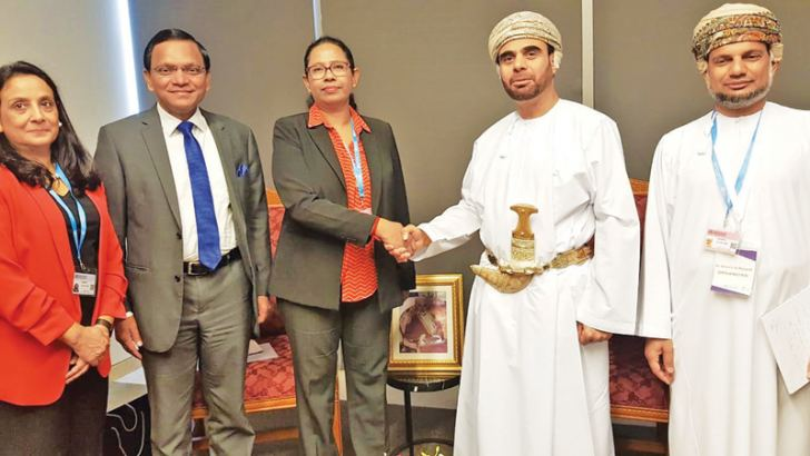 Health, Nutrition and Indigenous Medicine Minister Pavithra Wanniarachchi greets Oman Health Secretary Dr. Mohammed Saif Al Hosni, while Sri Lankan Ambassador to Oman Omar Lebbe Ameerajwad, WHO (Sri Lanka) Country Representative Dr. Razia Pendse and an official look on.