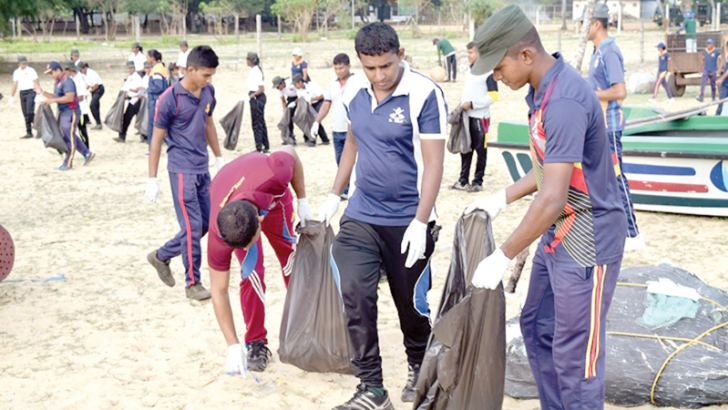 Troops cleaning the beach.